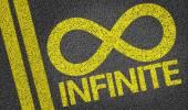 Infinite written on the road — Stock Photo