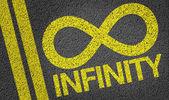 Infinity written on the road — Stock Photo