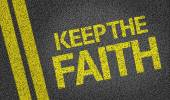 Keep the Faith written on the road — Stock Photo