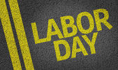 Labor Day written on the road — Stock Photo