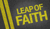Leap of Faith written on the road — Stock Photo