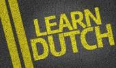 Learn Dutch written on the road — Stock Photo