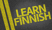 Learn Finnish written on the road — Stock Photo