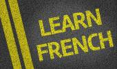 Learn French written on the road — Stock Photo