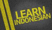 Learn Indonesian written on the road — Stock Photo