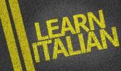 Learn Italian written on the road — Stock Photo