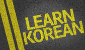Learn Korean written on the road — Stock Photo