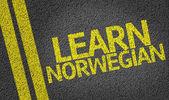 Learn Norwegian written on the road — Stock Photo