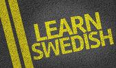 Learn Swedish written on the road — Stock Photo