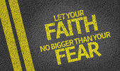 Let your Faith no Bigger than your Fear written on the road — Stok fotoğraf