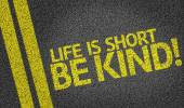 Life is Short Be Kind! written on the road — Stock Photo