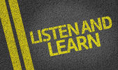 Listen and Learn written on the road — ストック写真