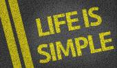 Life is Simple written on the road — Stock Photo