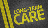 Long-Term Care written on the road — Stock Photo