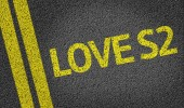 Love S2 written on the road — Stock Photo