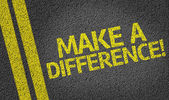 Make a Difference! written on the road — Stock Photo