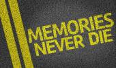 Memories Never Die written on the road — Stock Photo