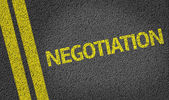 Negotiation written on the road — Stock Photo