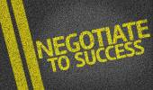 Negotiate to Success written on the road — Stock Photo