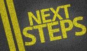 Next Steps written on the road — Foto de Stock