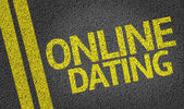 Online Dating written on the road — Stok fotoğraf