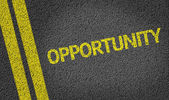 Opportunity written on the road — Stock Photo