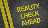 Reality Check Ahead written on the road — Stock Photo