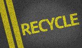 Recycle written on the road — Stock Photo