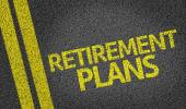 Retirement Plans written on the road — Stock Photo