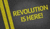 Revolution is Here written on the road — Stock Photo
