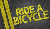 Ride a Bicycle written on the road — Stockfoto