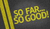 So Far... So Good written on the road — Stock Photo