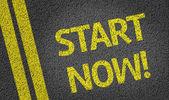 Start Now written on the road — Foto de Stock
