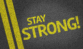 Stay Strong! written on the road — Stock Photo