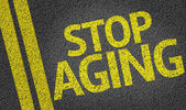 Stop Aging written on the road — Stock Photo