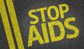 Stop AIDS written on the road — Stock Photo