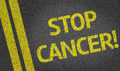 Krebs, geschrieben auf der Straße zu stoppen — Stockfoto