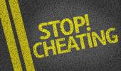 Stop Cheating written on the road — Stock Photo