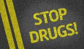 Stop Drugs written on the road — Stock Photo