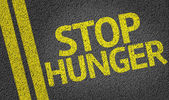 Stop Hunger written on the road — Stock Photo