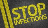 Stop Infections written on the road — Stock Photo