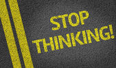 Stop Thinking! written on the road — Stok fotoğraf