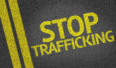 Stop Trafficking written on the road — Stock Photo