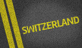 Switzerland written on the road — Stock Photo