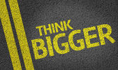 Think Bigger written on the road — Stock Photo