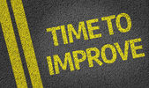Time to Improve written on the road — Foto de Stock