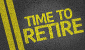 Time to Retire written on the road — Stockfoto