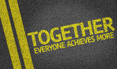 Together Everyone Achieves More written on the road — Stock Photo
