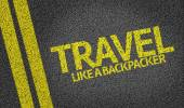 Travel, Like a Backpacker written on the road — Stock Photo