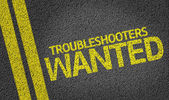 Troubleshooters Wanted written on the road — Foto de Stock